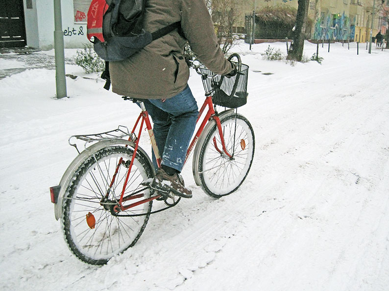 Man biking on a snowy road