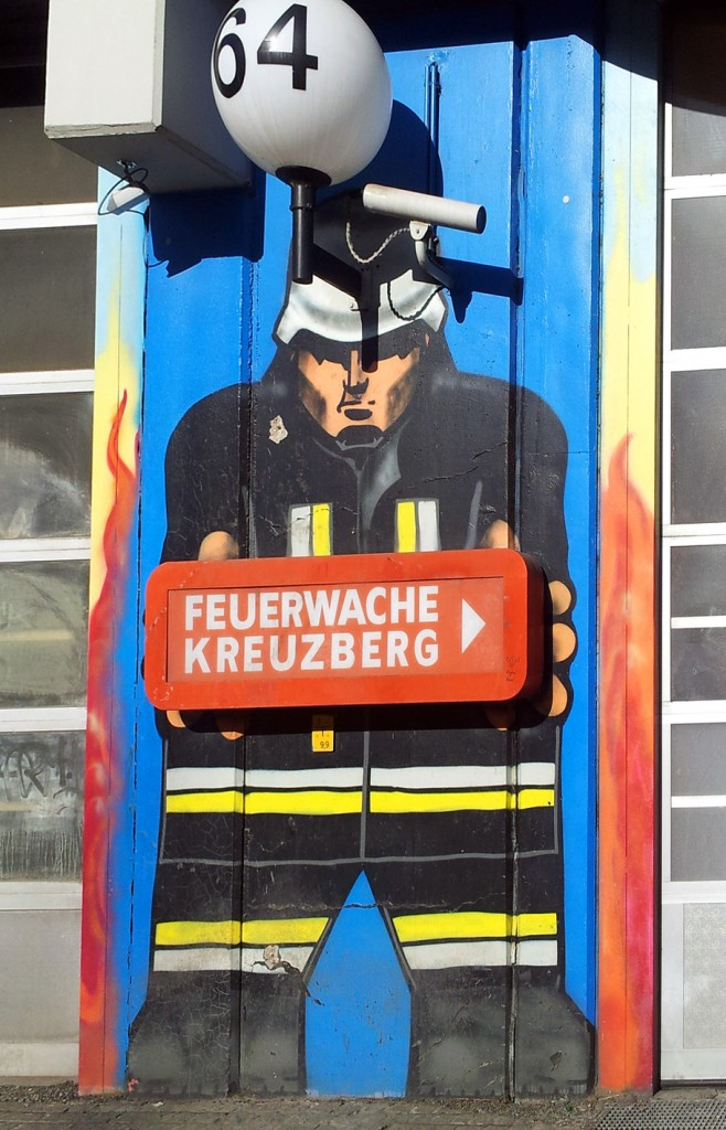 Kreuzberg Fire Station: graffiti fire fighter and stylized flames