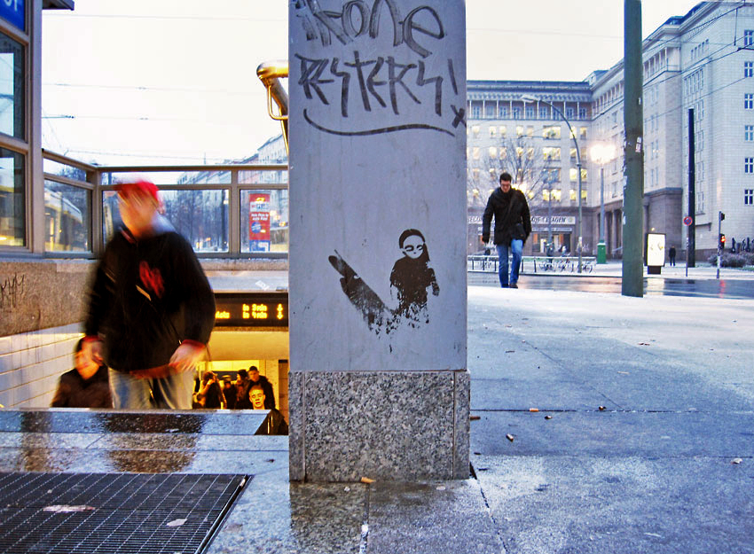 "Graffiti at Berlin ""Frankurter Tor"" Subway entrace of the little woman with a shadow"