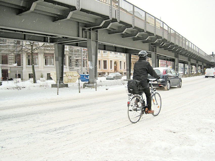commuter in Berlin riding a bike in heavy snow, photo by xhiller, 2011
